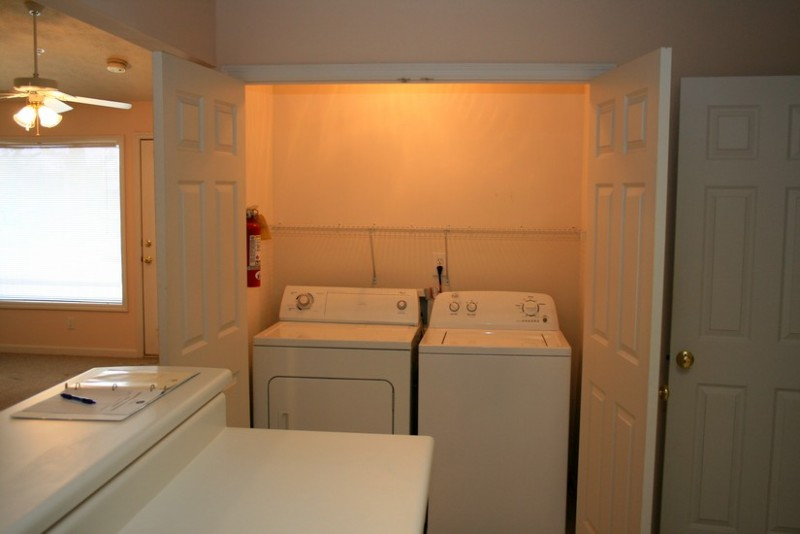 Full size washer and dryer. Nice storage above appliances.